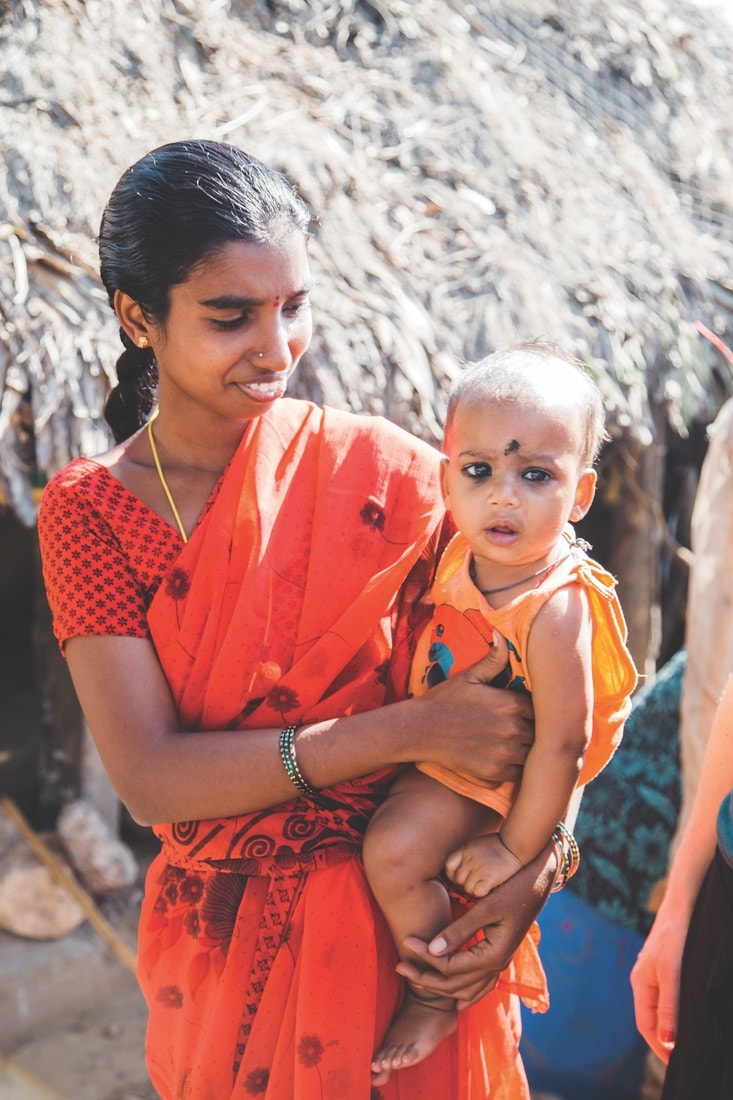 A mother and child in a rural village in India, VIE Magazine June 2018
