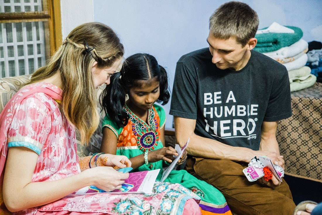 Preshanti, Jake and Hannah opening gifts, VIE Magazine June 2018