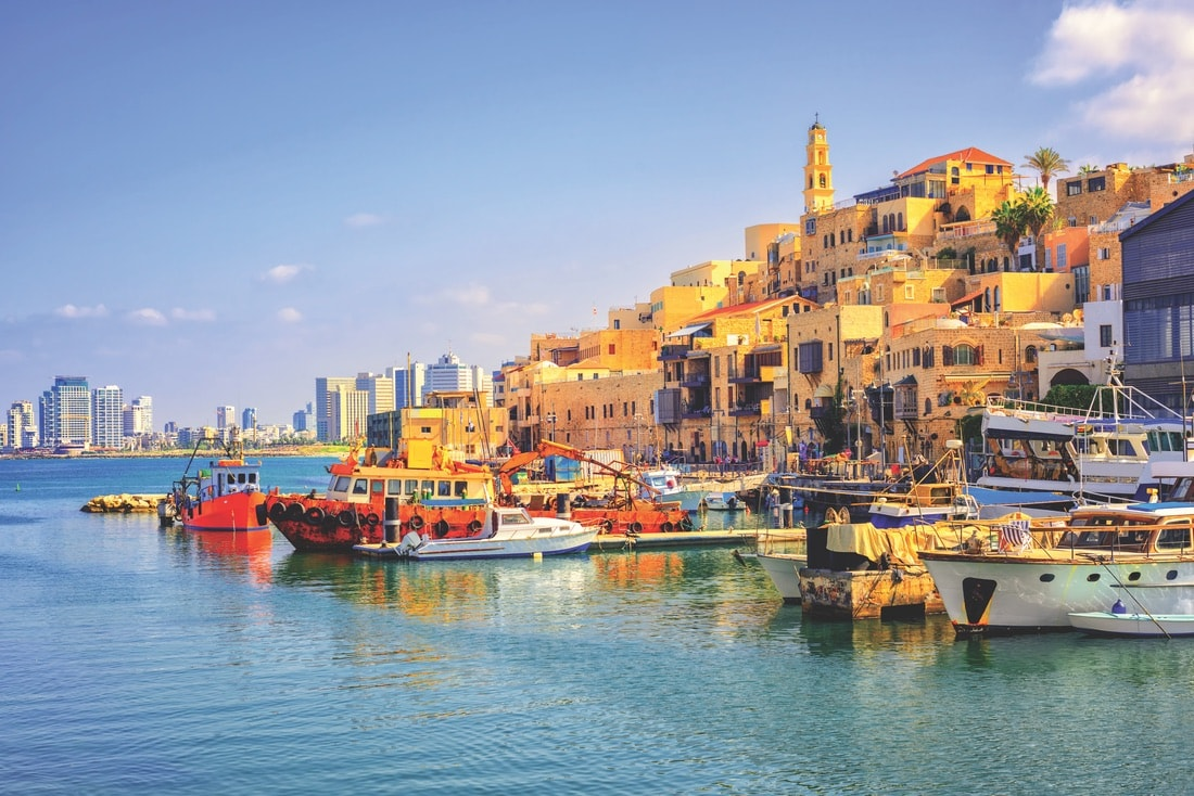 Tel Aviv's colorful old town and port of Jaffa with the modern skyline in the distance