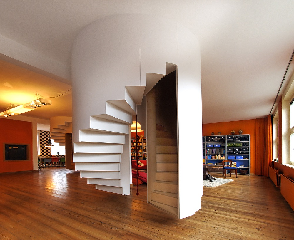 Back view of 1 set of the spiral staircases in the living room that leads to the boys' room upstairs.