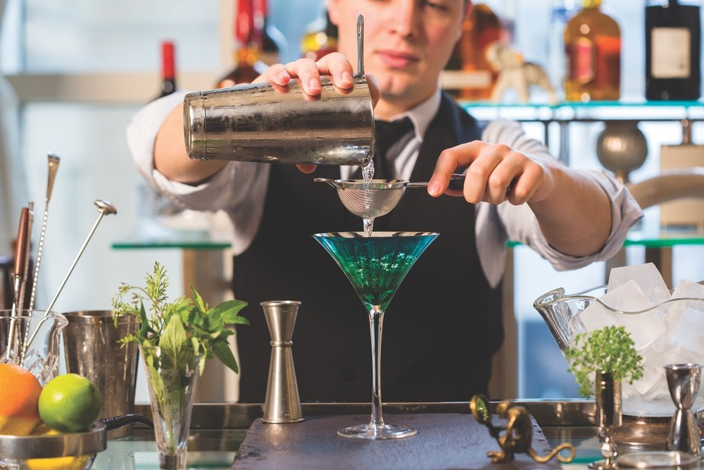 Mixologist Vlad Novikov pours a creative Cucumber Blossom cocktail at Z Bar.