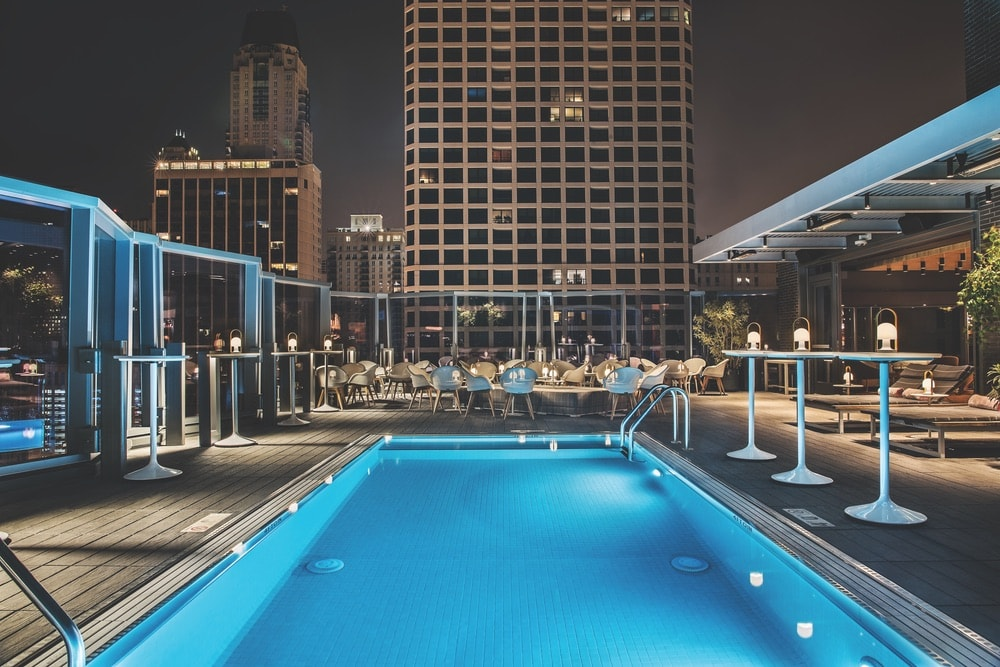 Devereaux, the rooftop pool and lounge at the Viceroy Chicago hotel, is a 1970s-chic spot for drinks and views of Lake Michigan.