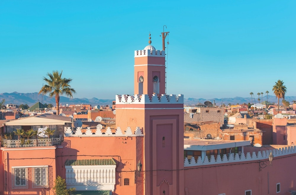 A panoramic view of Marrakech with a minaret standing above the old medina