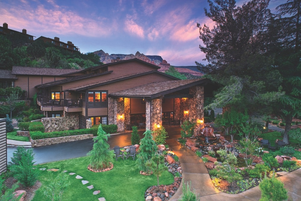 A view of the lodge building's exterior at sunset at L'Auberge de Sedona in Arizona.