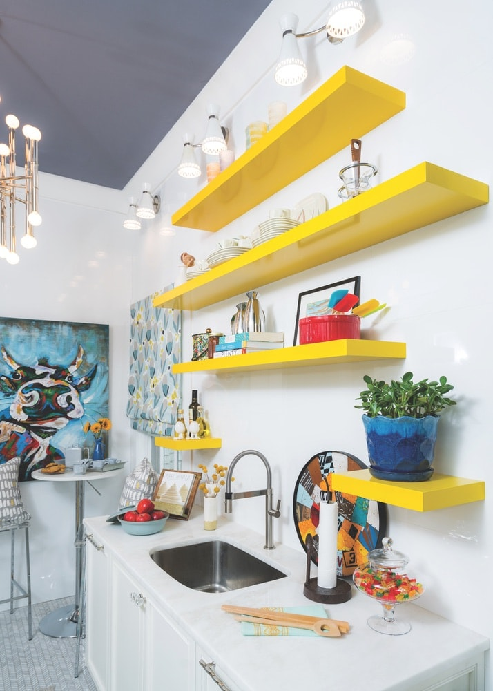 Pops of bright color and whimsical art liven up this kitchen design at the 1514 Home shop in Pensacola, Florida.