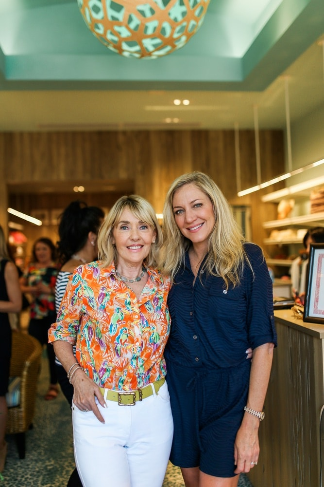 Lisa Burwell and Laurie Hood at VIE Magazine's sip and shop at JMcLaughlin in Grand Boulevard Town Center benefiting Alaqua Animal Refuge