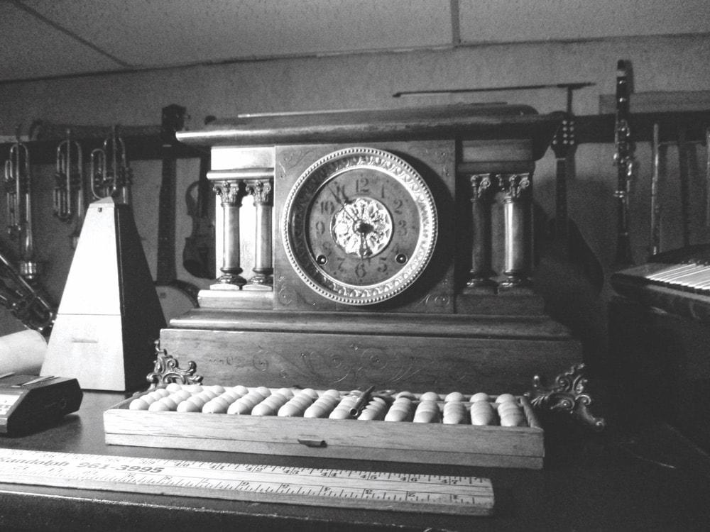 Seth Thomas Adamantine mantel clock sitting on a piano in black and white