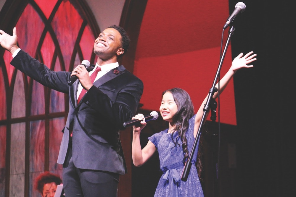 L. Steven Taylor of Broadway's The Lion King on stage with a student during a performance of Break a Leg's Rise Up! A Cabaret this past February.