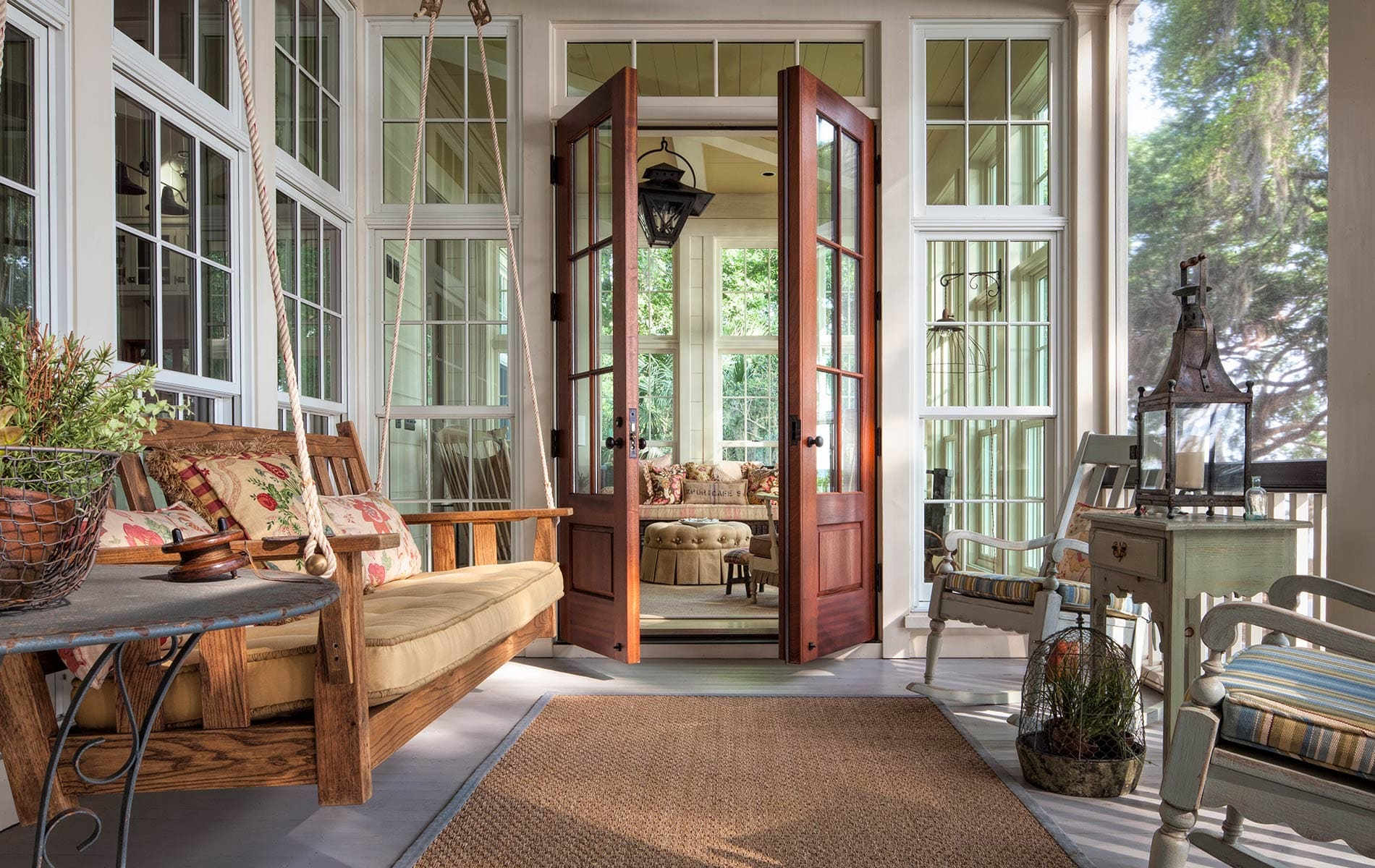 This charming screened back porch with a swing on Daufuskie Island near Hilton Head, South Carolina
