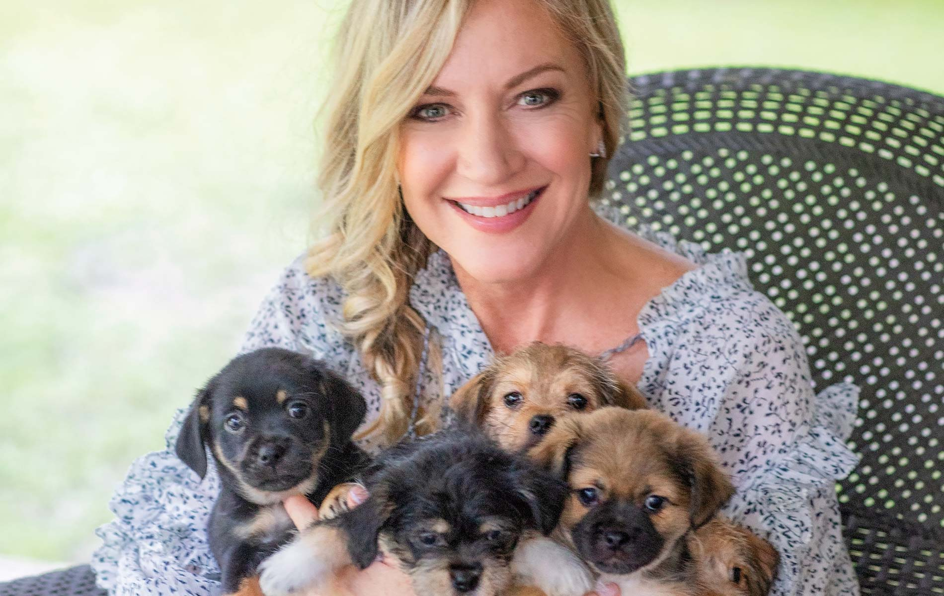 Laurie Hood with a new littler of puppies
