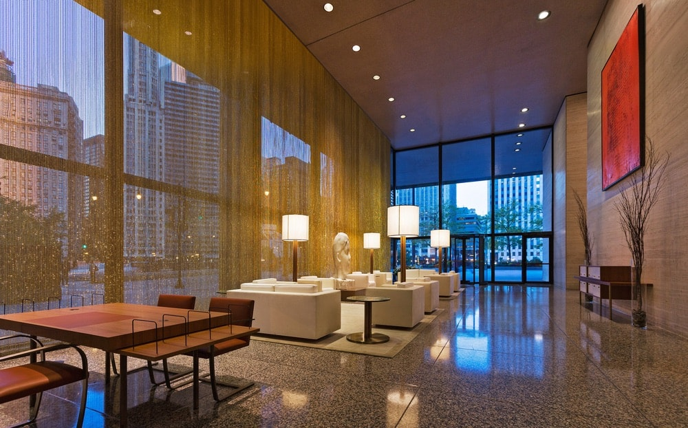 Floor-to-ceiling bronze beaded curtains and golden light make the space a luxurious sight from street level.
