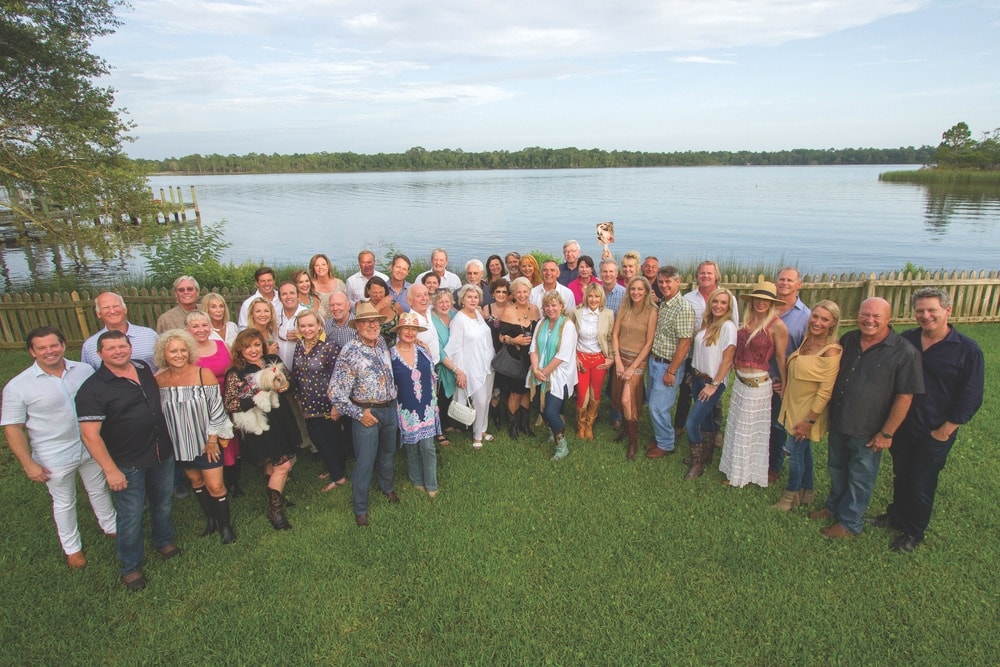 Patrons gather by the Choctawhatchee Bay at the home of Laurie and Taylor Hood for the Fifth Annual 100-Point and Cult Wine Dinner benefiting Alaqua Animal Refuge.