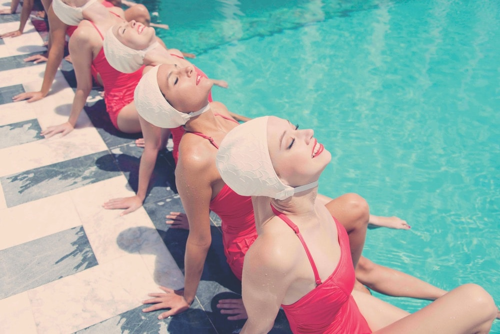 Aqua Glam was inspired by the elegance and glamour of synchronized swimming in the early twentieth century, featuring the Aqualillies as Gray Malin's muse.