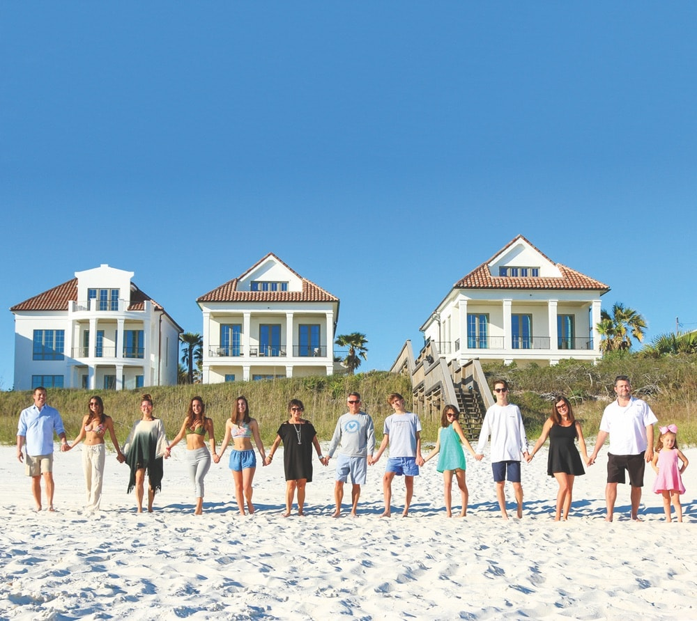 "Broker of Rosemary Beach Realty and ""The Smile of 30-A"" Linda Miller with her family at the Escape compound's 173 feet of white-sand beach"