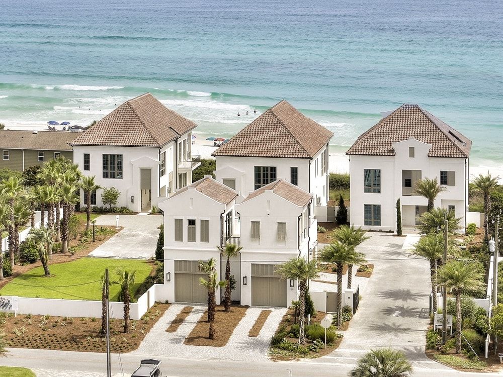 The compound's separate garage with rooftop pool, gated motorcade, and private beach access make it the perfect retreat for large families, events, corporate retreats, or just getting away from it all!
