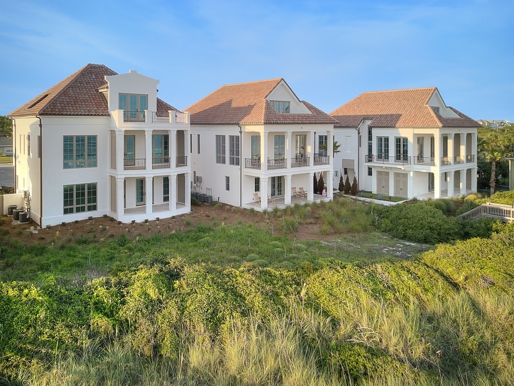 The luxurious three-home gated compound at 24–44 Escape Drive in Inlet Beach, Florida, is available for purchase. Visit LindaMillerLuxury.com to learn more.