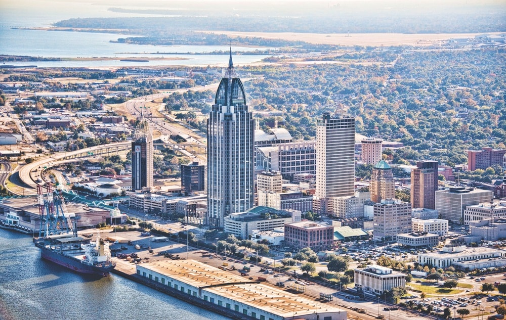 Mobile's skyline and the port of Mobile—considered the ninth busiest port in the nation.