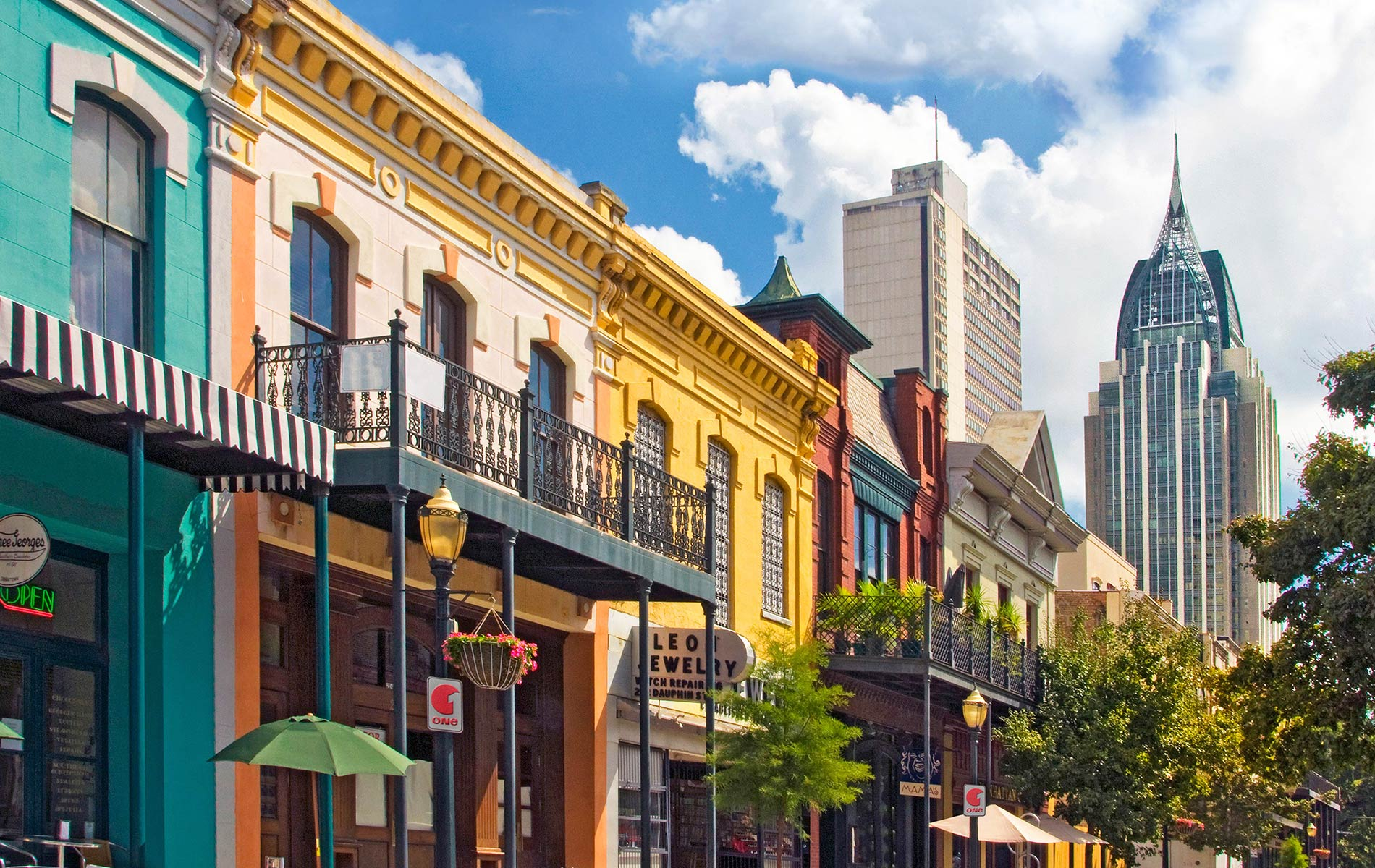 Charming and colorful historic facades of old downtown are juxtaposed against the striking modern Mobile, Alabama skyline.