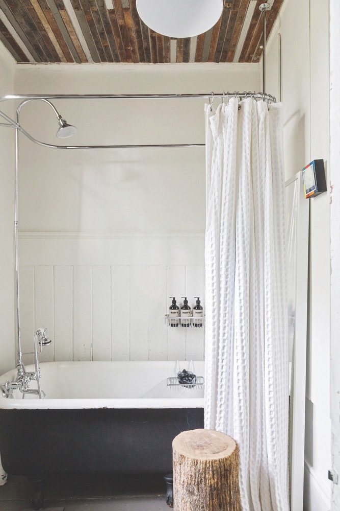 Wood laths salvaged from the renovation were put to use as a creative ceiling in the bathroom and bedroom.