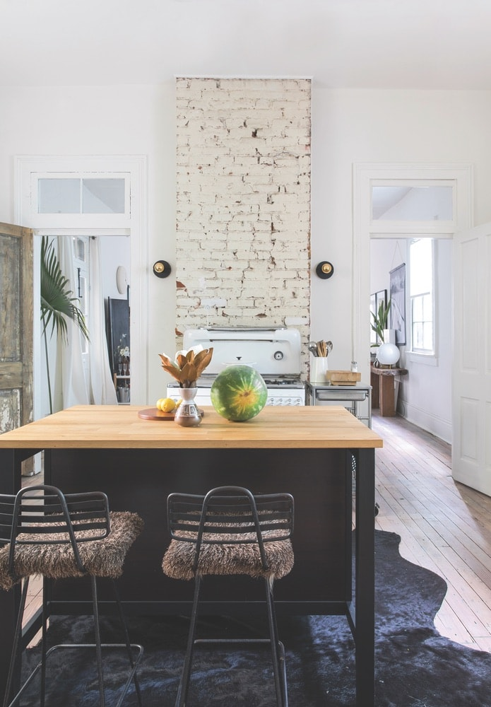 Dupré was sure to make use of space wisely throughout the small shotgun house; for example, the movable kitchen island doubles as a dining space.