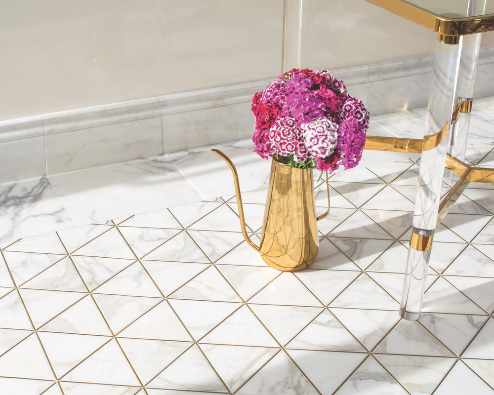 Hoffman, a waterjet stone mosaic by New Ravenna, is shown here in honed Calacatta Gold and Brass.