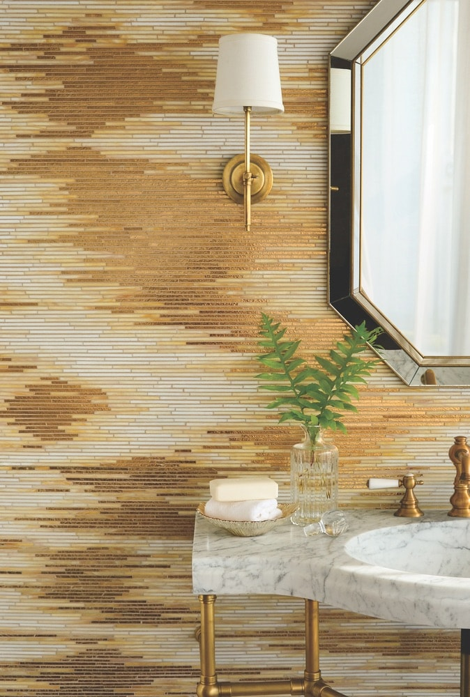 Simone, another waterjet stone mosaic from New Ravenna's Trove collection, is shown in honed Calacatta Gold, honed Thassos, and brushed Bronze.