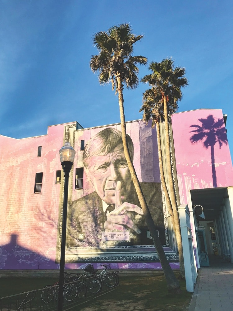 Street artist Gaia painted this mural commemorating architect and professor Vincent Scully on the iconic purple wall at 25 Central Square in January of 2018. Photo by Jordan Staggs