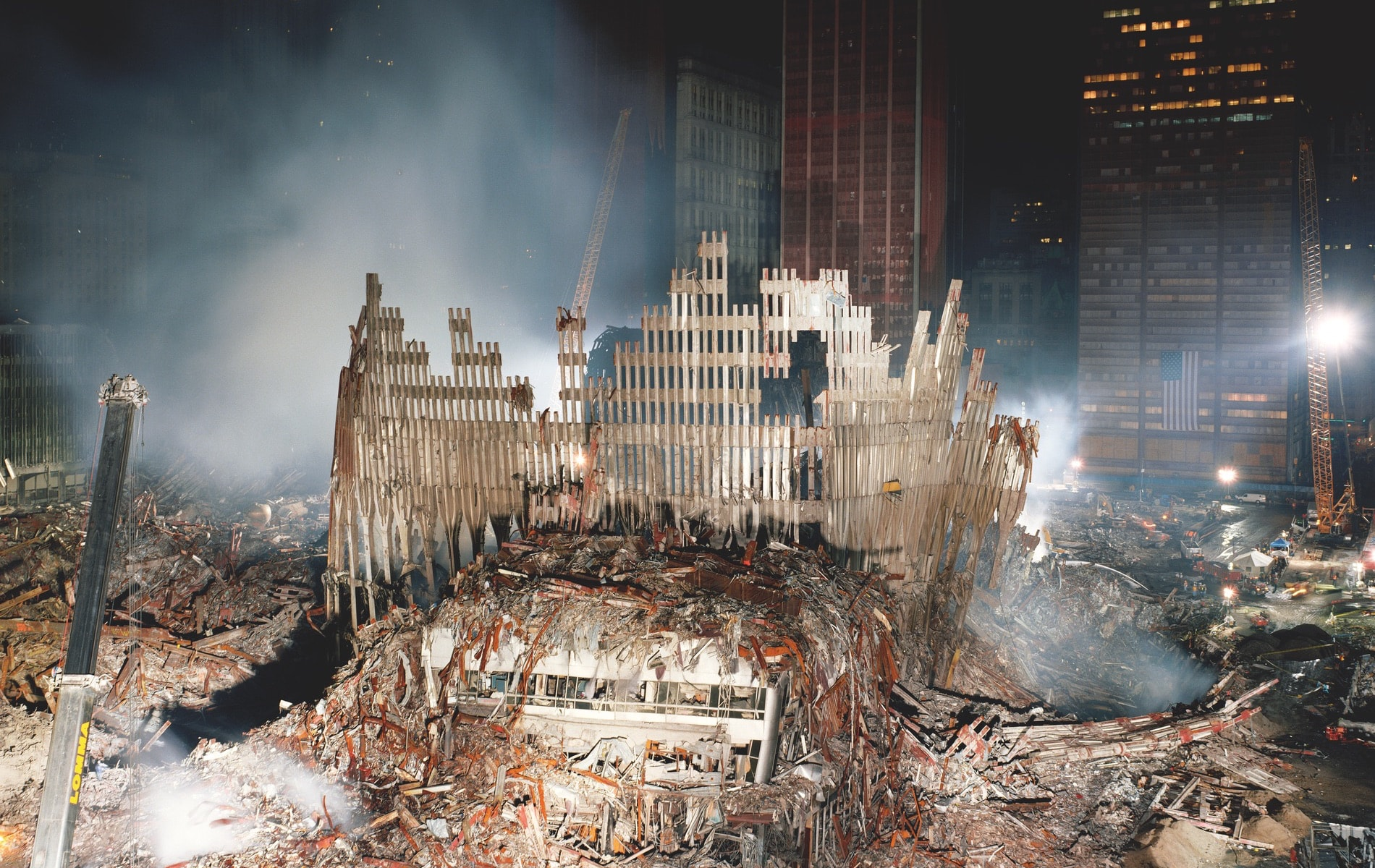The base of the North Tower, looking east toward the Woolworth Building from Ground Zero in New York City, 2001 © Joel Meyerowitz