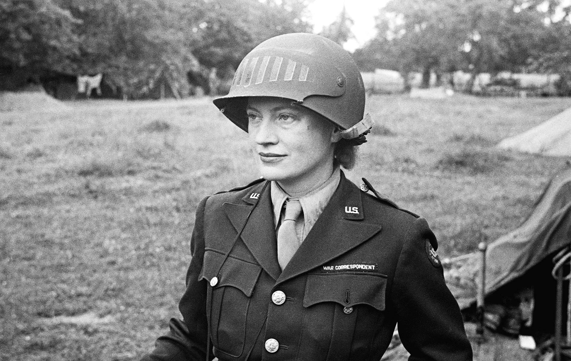 Lee Miller in steel helmet specially designed for using a camera, Normandy, France 1944