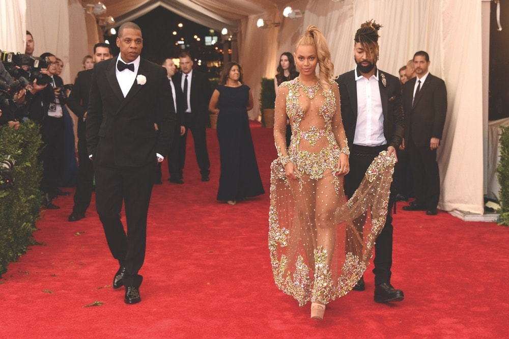 Ty Hunter assists Beyoncé as she walks the red carpet with husband Jay-Z at the 2015 Met Gala.