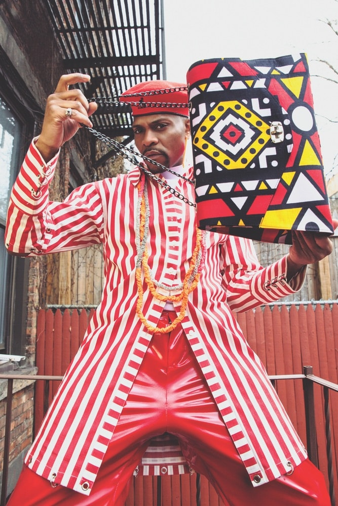 DapperAfrika modeling clothes and a bag