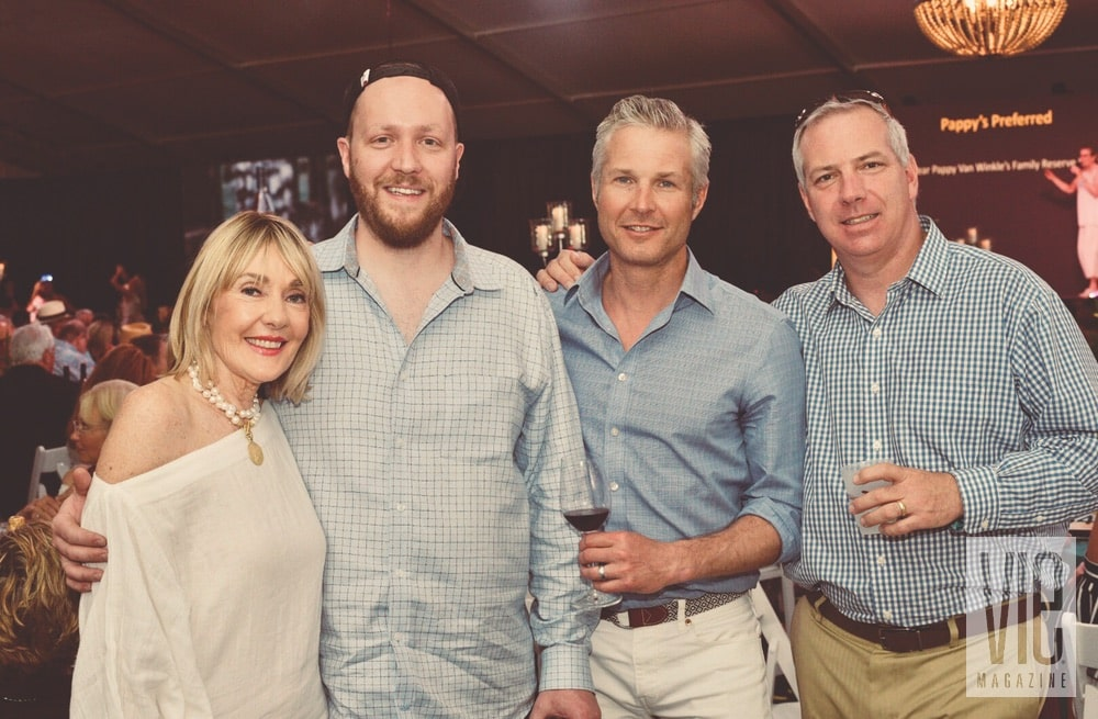 Lisa Burwell, Tyson Peterson, Daned Kirkham, and Eric Wagenknecht at the Destin Charity Wine Auction Foundation (DCWAF) event