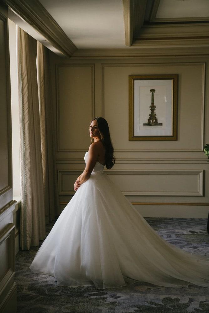 Ellie Romair standing in her wedding dress