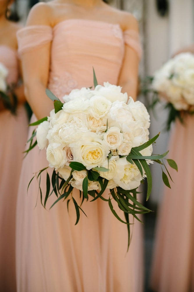 a bridesmaid holding a bouquet