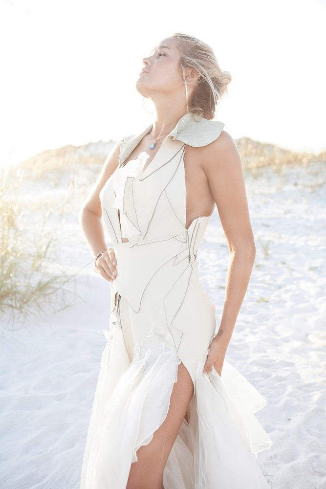 Nicole Paloma Bridal, one model in a wedding gown on the beach