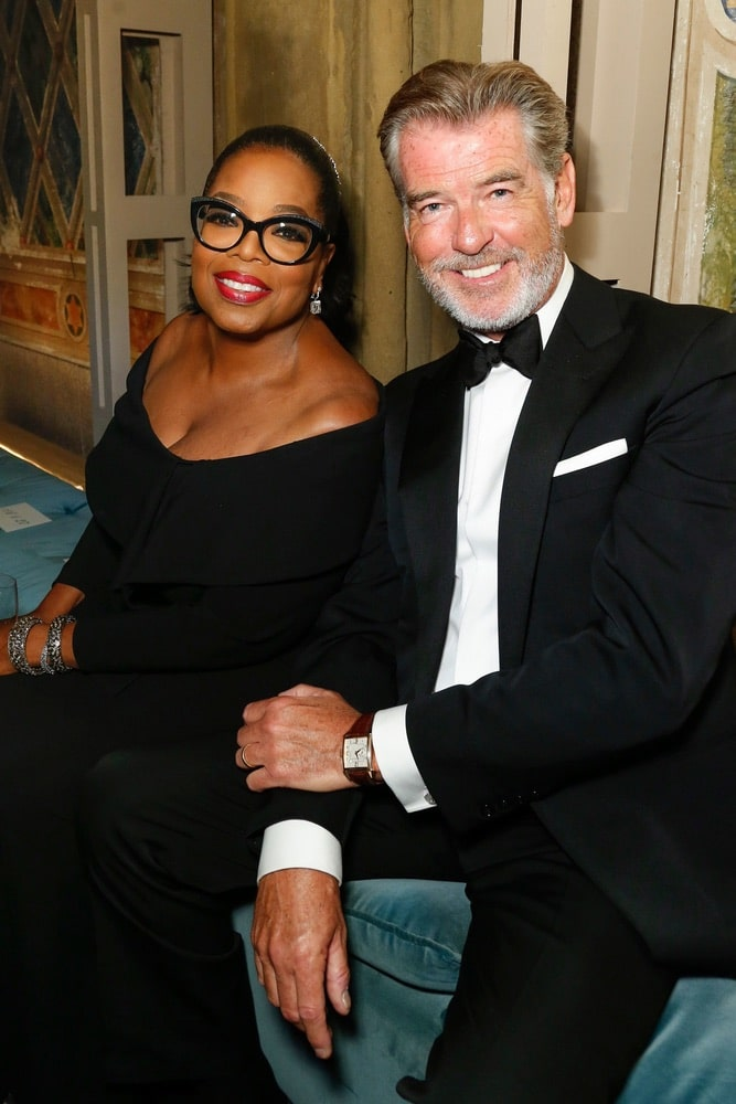 Oprah Winfrey and Pierce Brosnan at Ralph Lauren's Fall 2018 50th Anniversary runway show at NYFW