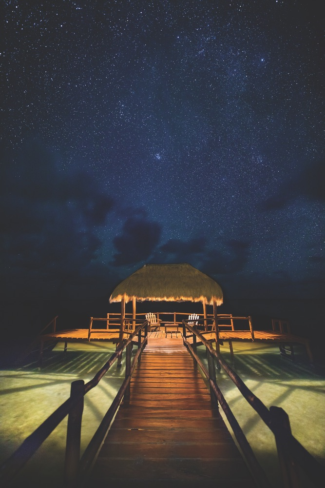 Stargazing at night on a lagoon pier from the Yucatán beaches at Mukan Resort