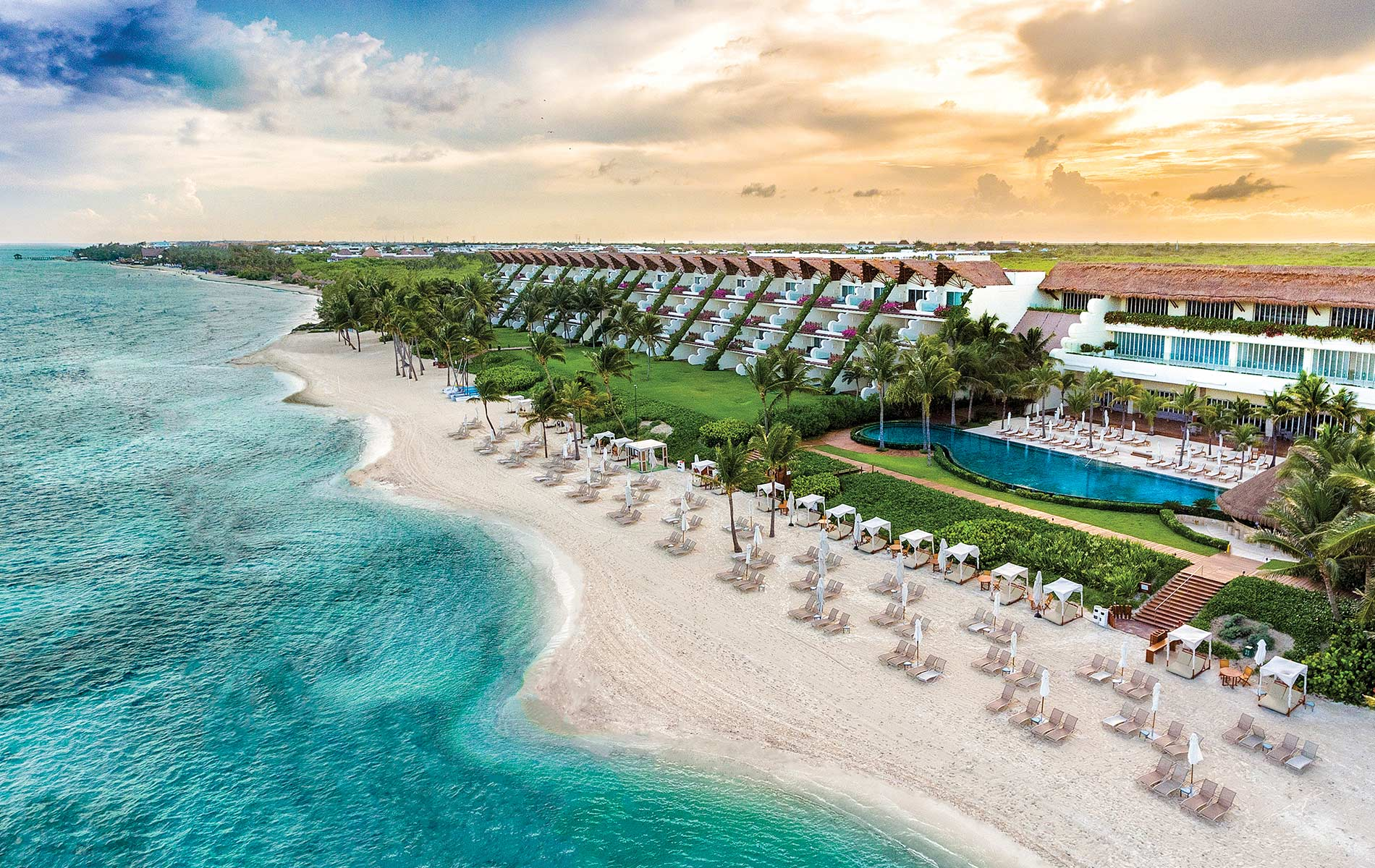 The Grand Velas Riviera Maya resort in Mexico's Yucatán Peninsula view of the beach and resort at sunset
