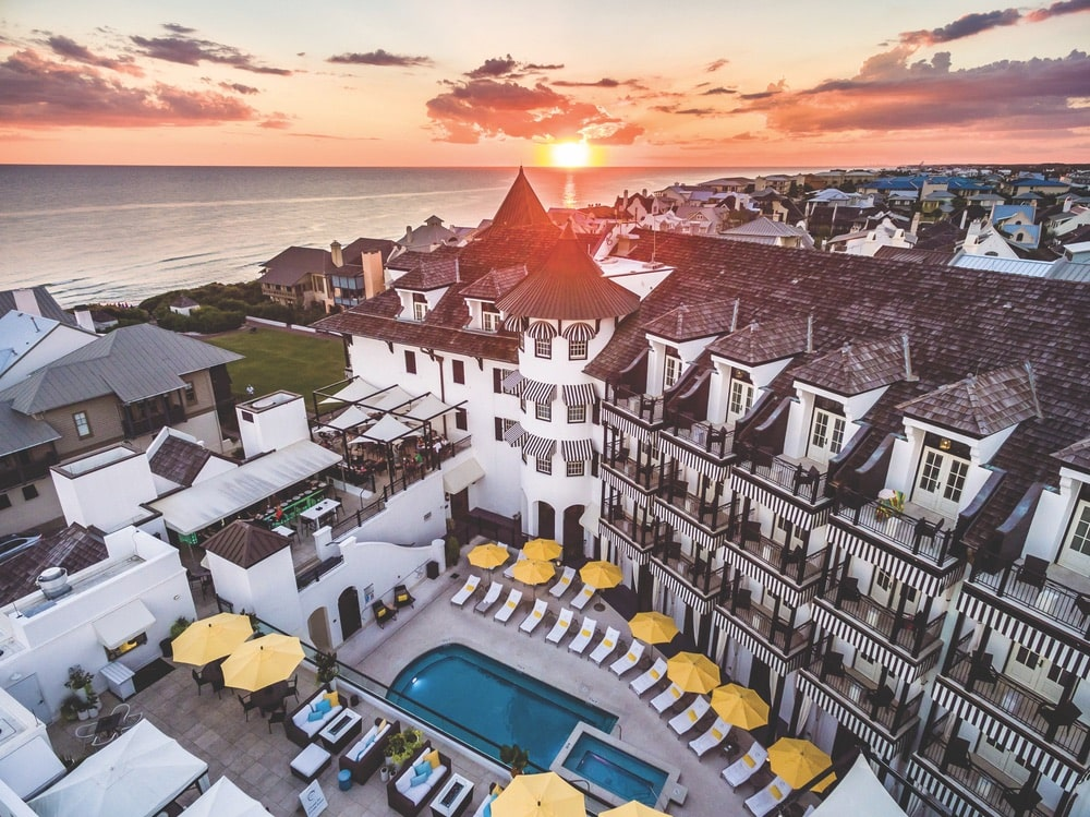 Upper view of The Pearl Hotel's pool and rooftop lounge in Rosemary Beach, Florida at sunset