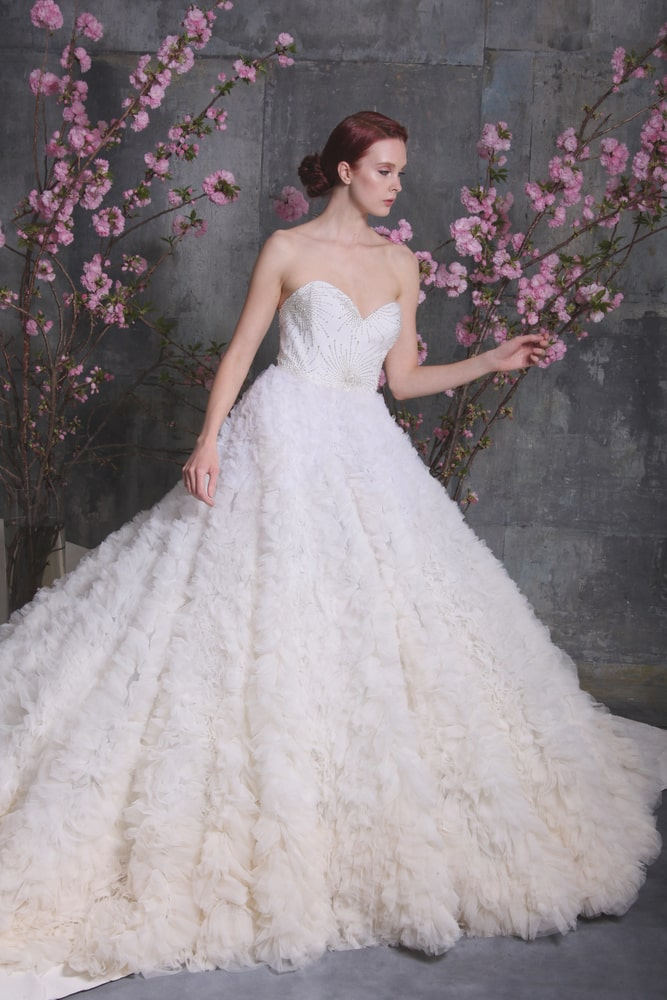 Girl modeling a wedding dress from the Christian Siriano Bridal line