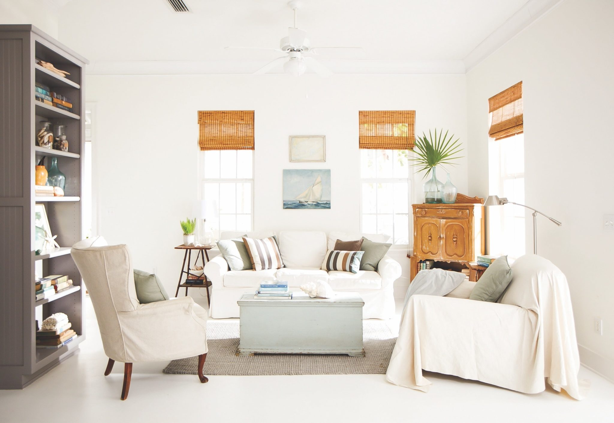 Interior designer Holly Shipman used beachy accents and a natural color palette for the inviting sitting room at this home in Seagrove Beach, Florida.