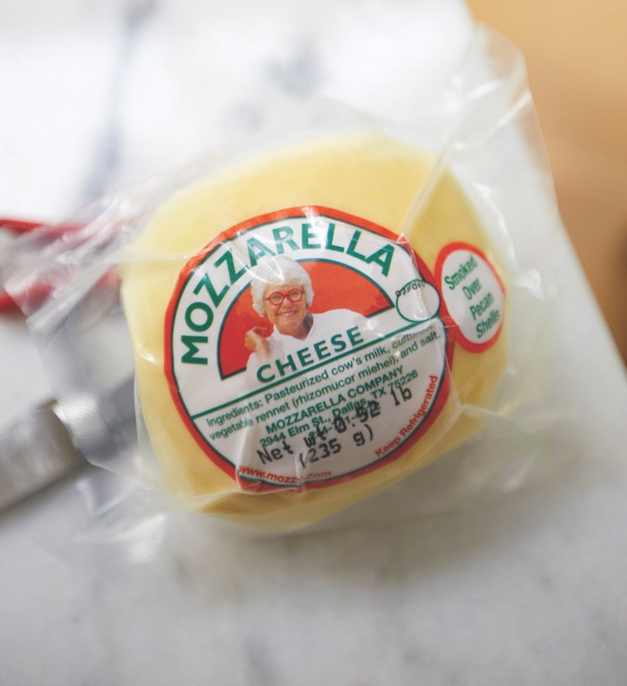 A ball of Paula Lambert's Mozzarella cheese with her face on the label wrapped in plastic