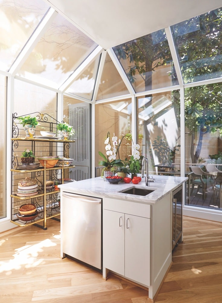 The open and airy kitchen at Lambert's Turtle Creek home in Dallas, Texas is perfect for cooking and entertaining.