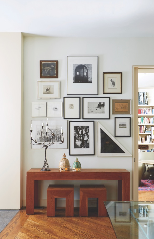 Collection of art on the wall at Paula Lambert's Turtle Creek home in Dallas, Texas