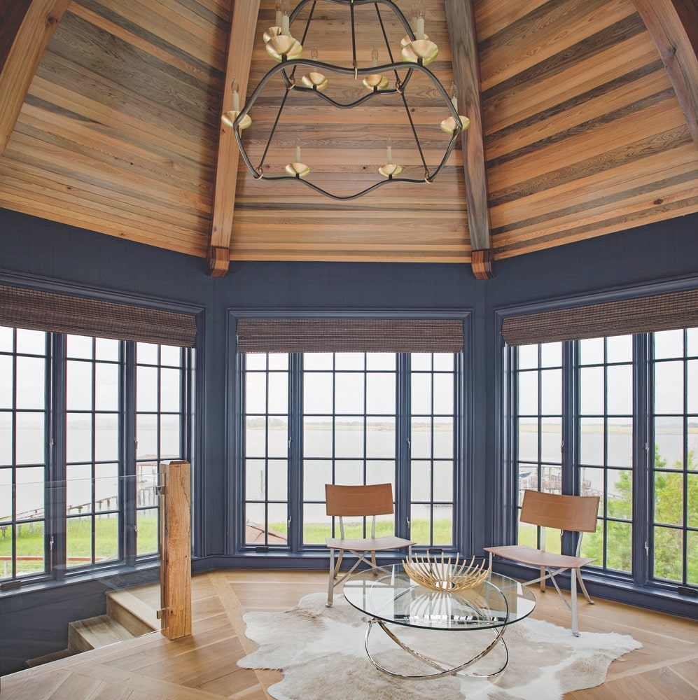 View of a room with 360 views of windows looking at the home's property shot by Richard Leo Johnson