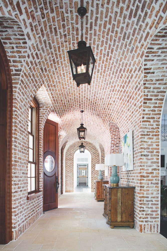 Beautiful, arched hallway completely covered in red brick shot by Richard Leo Johnson