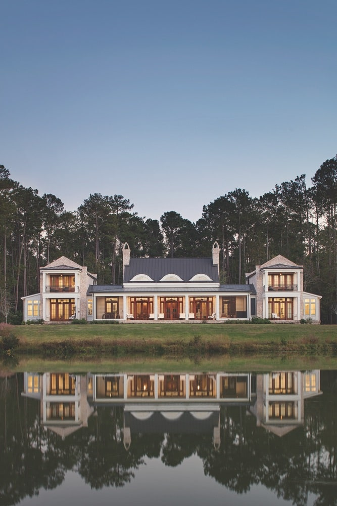 Exterior of a symmetrical, Southern red bricked home sitting on the waters edge shot by Richard Leo Johnson