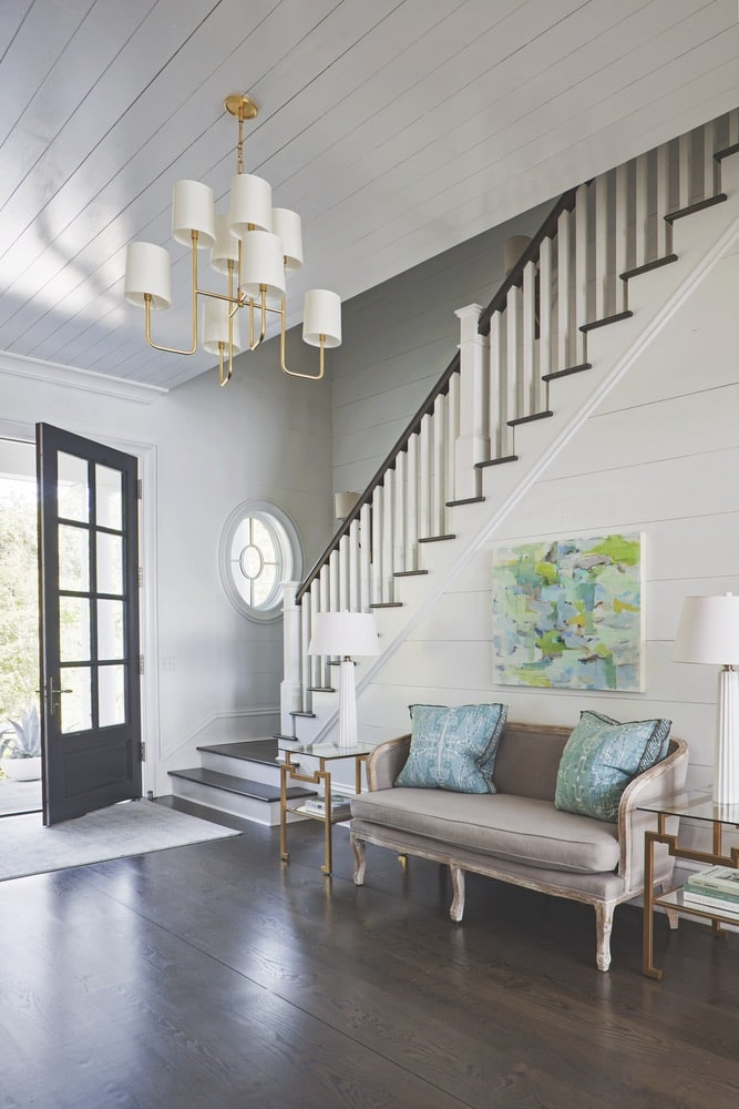 Front door and stairwell showing off white wood walls and dark wood floors shot by Richard Leo Johnson