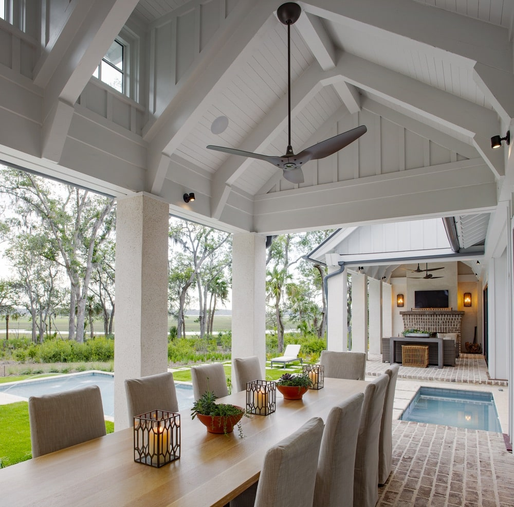 Outdoor eating area overlooking the pool and white woodwork shot by Richard Leo Johnson