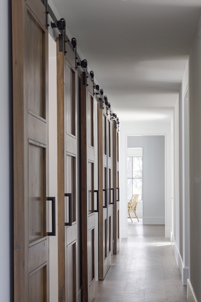 Wall of sliding barn doors in a hallway shot by Richard Leo Johnson